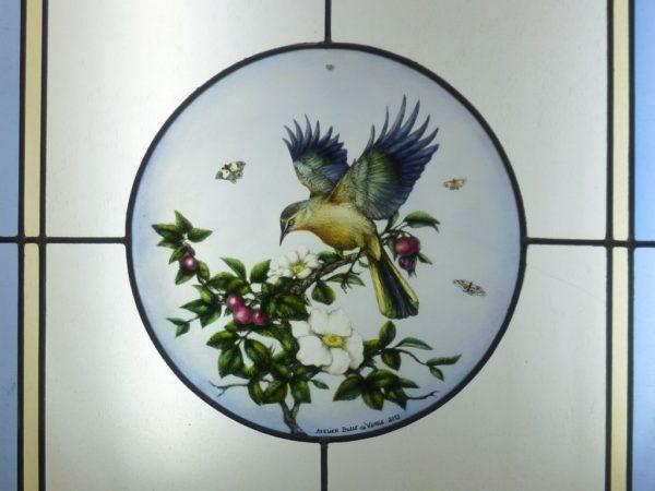 médaillon d'un oiseau sur cerisier